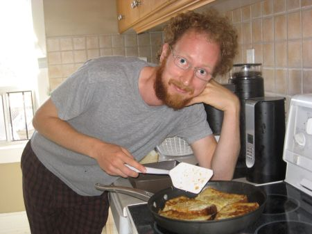 Aaron frying up some french toast.