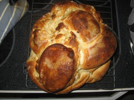 A funny looking apple challah.